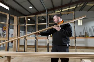 A member of the Manufactured Joinery Team working in the workshop